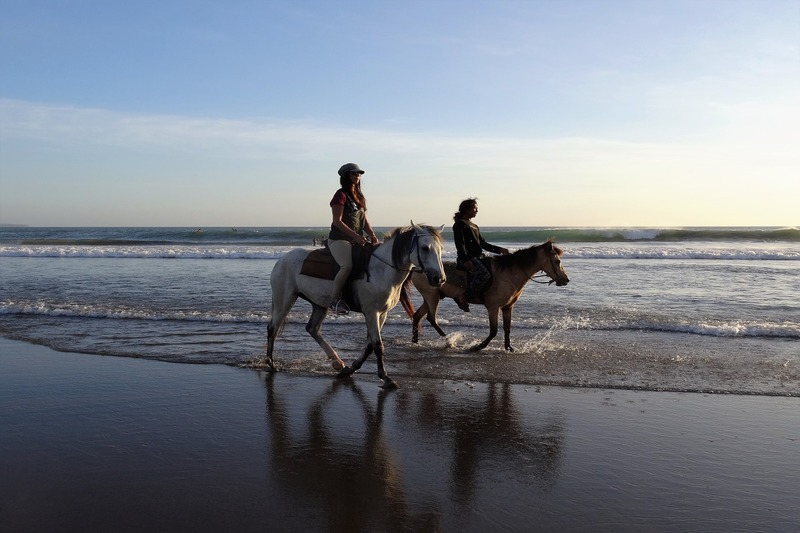 Horseback ride couple beach | bali, indonesia